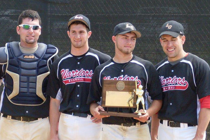 Baseball players holding a trophy